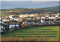 SD1680 : Millom cricket ground and houses beyond by Andrew Hill