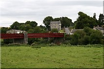 W9699 : Ballyduff Garda Station from across the river by Paul O'Farrell