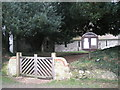 SU7531 : Entrance to the Church of the Holy Rood, Empshott by Basher Eyre