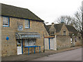 TL0097 : King's Cliffe: village shop and school by Stephen Craven