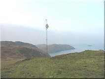 SH4094 : WT mast and navigational aid on the summit of Torllwyn by Eric Jones