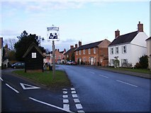 TM3973 : A144 The Street, Bramfield & Village Sign by Adrian Cable