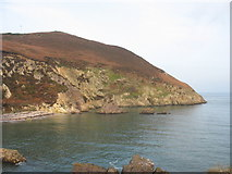 SH4094 : The Torllwyn headland and the purple stacks from the top of the natural arch by Eric Jones