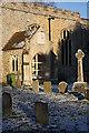 TL7963 : Porch and gravestones, Little Saxham by Bob Jones
