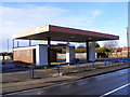 TM3055 : Former Petrol Filling Station by Adrian Cable