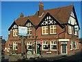 TQ7353 : The Bull Inn, East Farleigh and Village Sign by David Anstiss