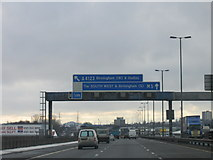 SO9988 : M5 Motorway Overhead Sign Approaching Junction2. by Roy Hughes