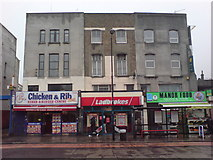 TQ3287 : Parade of Shops near Manor House Tube Station by Danny P Robinson