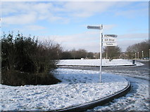 SU9850 : Signpost on the roundabout at the top of Stag Hill by Basher Eyre
