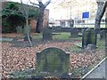 NZ2464 : Gravestones at the Parish Church of St Andrew by Stephen Sweeney