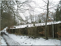 SU9948 : Long fence obscuring view of the overflow graveyard for Guildford Cemetery by Basher Eyre