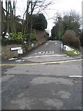 SU9948 : Stop sign on the road at the foot of Artington Walk by Basher Eyre