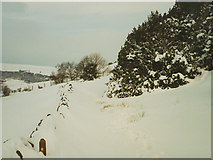SE0125 : Snow-filled footpath off Stake Lane by Stephen Craven