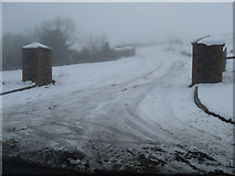 J3052 : A snowy track and entrance leading off the B2 by James Denham