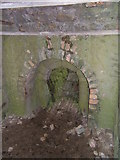 NU1341 : Fireplace within the Limekilns by Barbara Carr