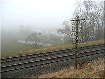 NY5636 : Disused telephone pole, Little Salkeld by Humphrey Bolton