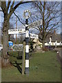 TL1070 : Signpost at Stow Longa by Michael Trolove