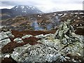NN9679 : Small cairn on the top of Dun Mor by wrobison
