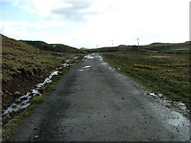 NG4055 : Old road at Kingsburgh by Dave Fergusson