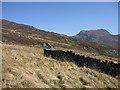 SH6428 : Stone walls reaching up to Rhinog Fawr by Rudi Winter