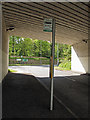 NZ5820 : Bus stop under the bridge by Stephen McCulloch
