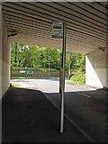 NZ5820 : Bus stop under the bridge by Stephen McCulloch