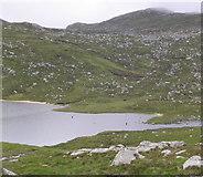 NH0077 : Fishermen in Lochan Fèith Mhic'-ilean by Russel Wills
