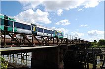 TQ0004 : Train crossing the River Arun by Chris Richardson