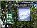 TL3266 : The White Swan Public House sign, Conington by Adrian Cable