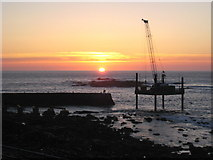 SW3526 : Sunset over Sennen Cove harbour by Rod Allday