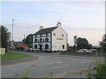 SJ2618 : The Golden Lion at Four Crosses by John Firth
