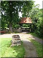 NZ3411 : Mounting block and lych gate, Low Dinsdale by Gordon Hatton