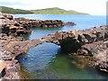 NX8047 : Natural Arch on Rascarrel Shore by Ed Iglehart