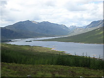 NH1804 : A scene overlooking forestry lands with Loch Loyne in the background by James Denham