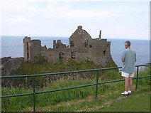 C9041 : Admiring the view, Dunluce Castle by Kenneth  Allen