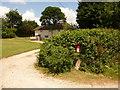 SY7698 : Dewlish: postbox № DT2 186, Chebbard Farm by Chris Downer