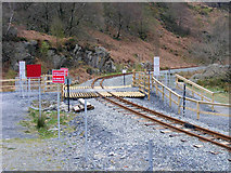 SH5947 : Footpath crossing the Welsh Highland Railway by Phil Champion