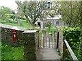 SX1497 : Letter box and church gateway, St Gennys by Humphrey Bolton