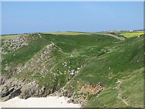 SW3821 : Coastal footpath above Porthchapel beach by Sarah Charlesworth