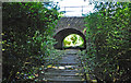 SX4460 : Footpath beneath railway bridge - Ernesettle, Plymouth by Mick Lobb