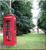 TM0890 : K6 Telephone box on green by Boosey's Lane by Evelyn Simak