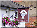 TL1313 : The Silver Cup Public House Sign by Adrian Cable
