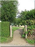 TM3395 : Churchyard gate by Evelyn Simak