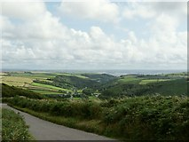 SS4939 : A view towards the Taw estuary across the valley occupied by the A361 by Roger A Smith