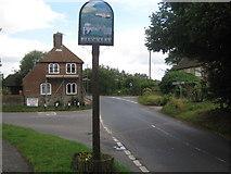 TQ9245 : Pluckley Village Sign by David Anstiss