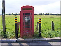 TM4598 : Telephone Box in Haddiscoe Railway Station Car Park by Adrian Cable