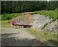 NN7960 : Timber trailer in forest track layby by Russel Wills