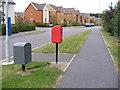 TM3763 : Brook Farm Road & Heron Road Postbox by Geographer