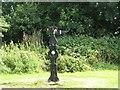 NS3042 : Millennium milepost, Kilwinning by Richard Webb
