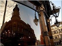 TQ2775 : Pub window at The Falcon, Saint John's Hill by tristan forward